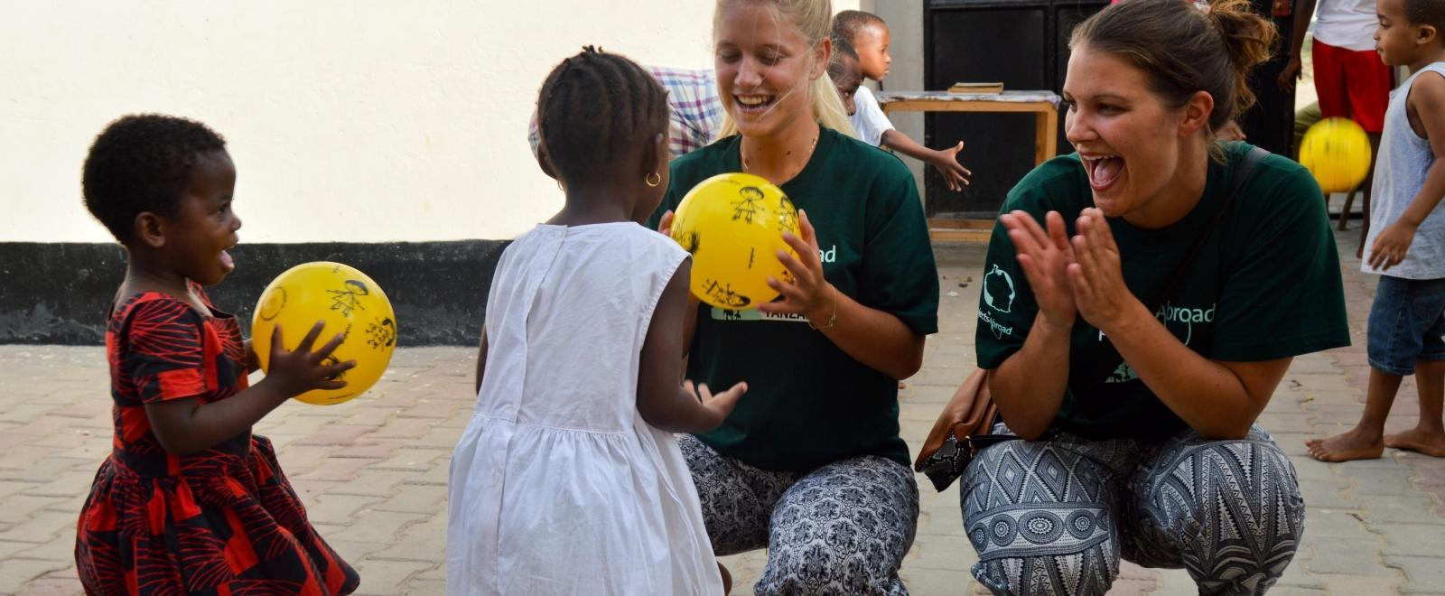 Projects Abroad volunteers play a ball game with children from a nursery school rather than an orphanage abroad.